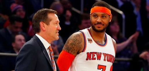 Carmelo Anthony of the New York Knicks stands with