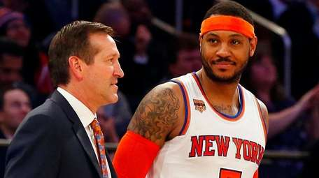 Carmelo Anthonyof the New York Knicks stands with