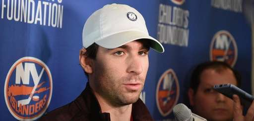 New York Islanders center John Tavares speaks to