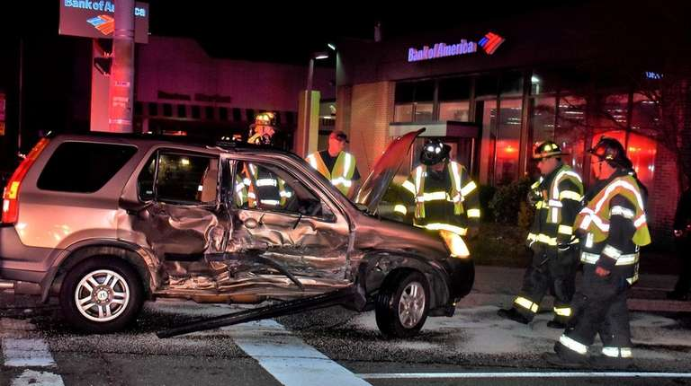 Firefighters respond to a crash on Middle Country