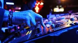 DJ Jeff Yahney spins new tracks during the