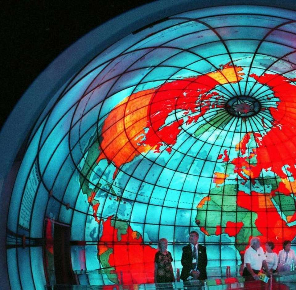 Visitors gaze at the Mapparium at The Mary