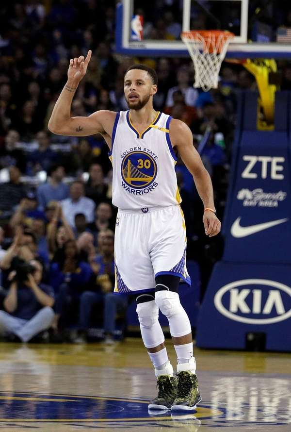 Golden State Warriors guard Stephen Curry celebrates after