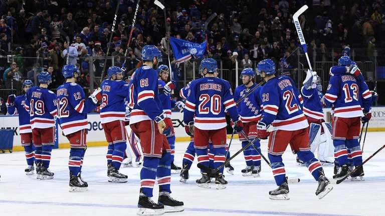 New York Rangers player salute the fans after