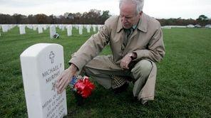 A file photo of Daniel J. Murphy touching