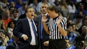 Kentucky head coach John Calipari argues a call