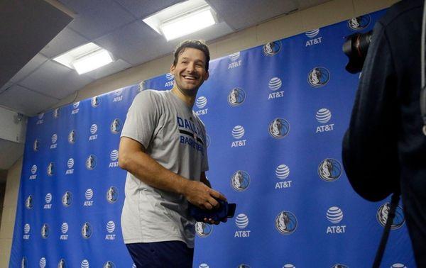 Former Dallas Cowboys quarterback Tony Romo smiles as