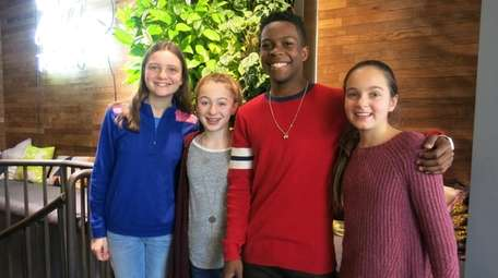 Dante Brown, second from right, with Kidsday reporters,