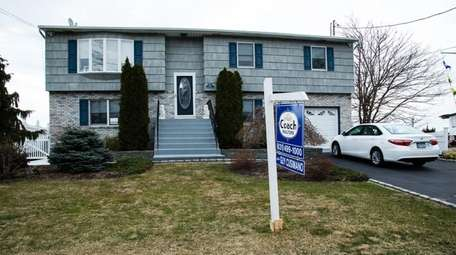 This waterfront two-family Lindenhurst house is on the
