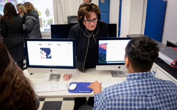 State Education Commissioner MaryEllen Elia speaks with students