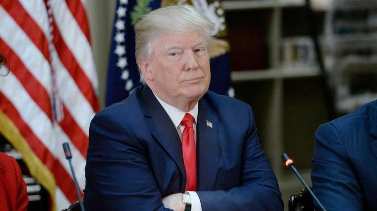 U.S. President Donald Trump, listens during a strategic