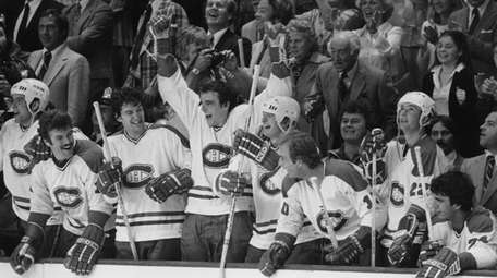 Players of the Montreal Canadiens on the bench