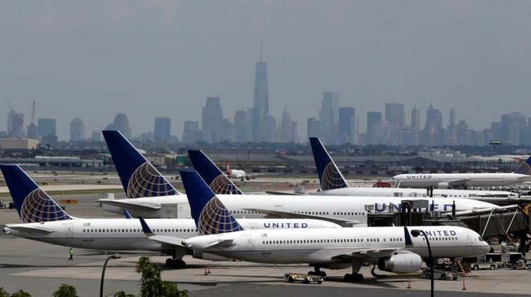United Airlines jets are parked on the tarmac