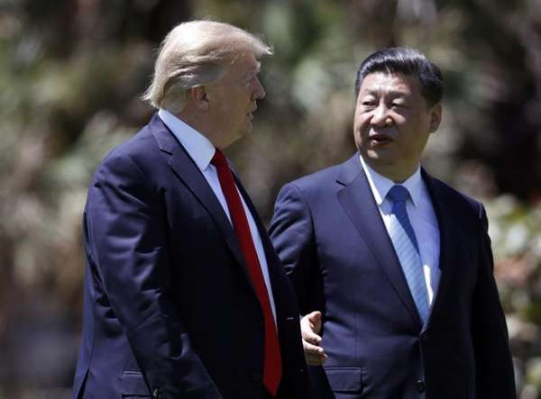 President Donald Trump, left, and Chinese President Xi