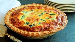 Asparagus, peas, spinach and bacon fill this quiche