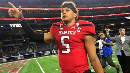 Texas Tech quarterback Patrick Mahomes II celebrates after