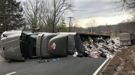 Garbage spilled when a truck heading to an