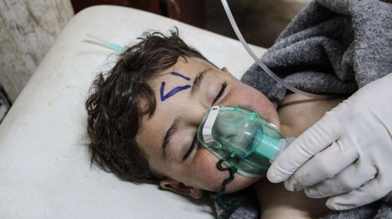 A child receives treatment after a chemical attack