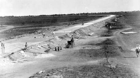 Workers build the Long Island Motor Parkway on