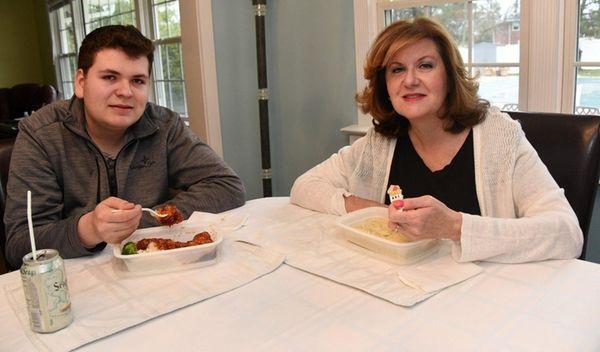 Jodi Wild and her son Joseph, 17, eat