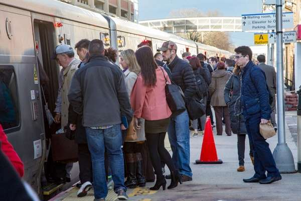 Commuters board the LIRR in Mineola on Friday,