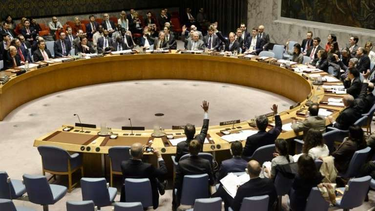 United Nations Security Council members show hands for