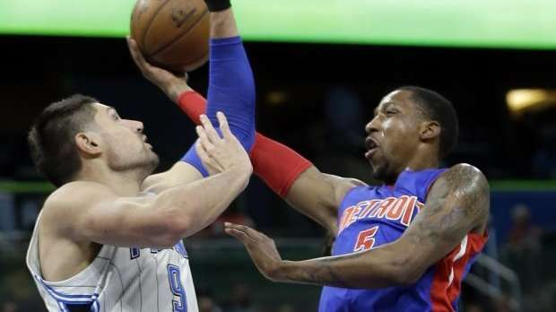 Detroit Pistons' Kentavious Caldwell-Pope, right, goes up for