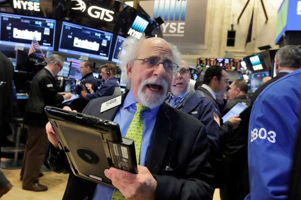 Trader Peter Tuchman works on the floor of