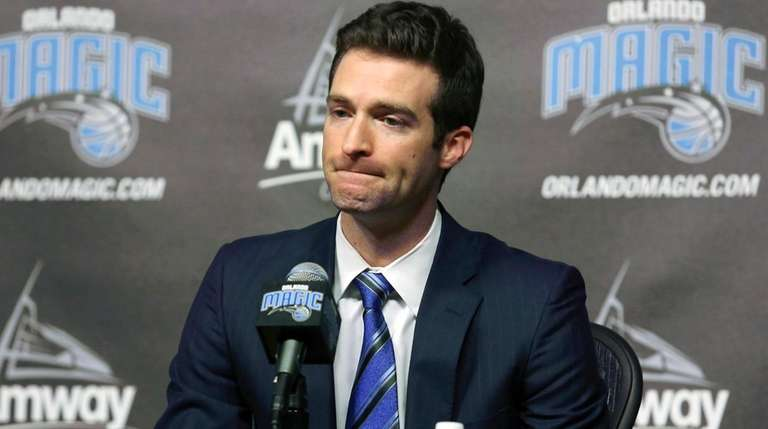 Orlando Magic general manager Rob Hennigan pauses to