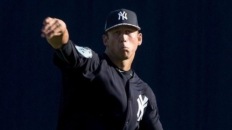 New York Yankees pitcher James Kaprielian warms up