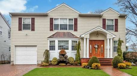 This Colonial in Garden City has been updated