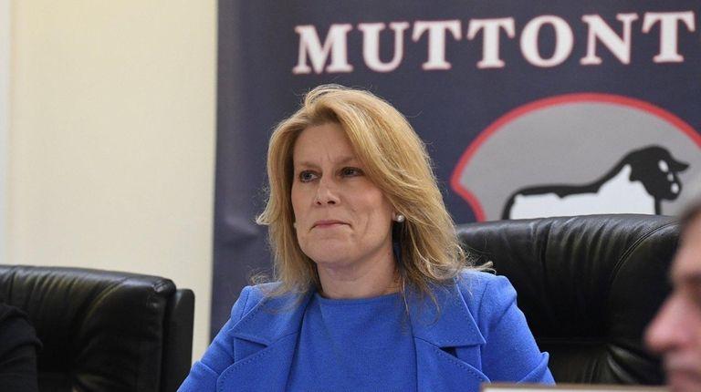 Muttontown Mayor Julianne Wesley Beckerman listens during a