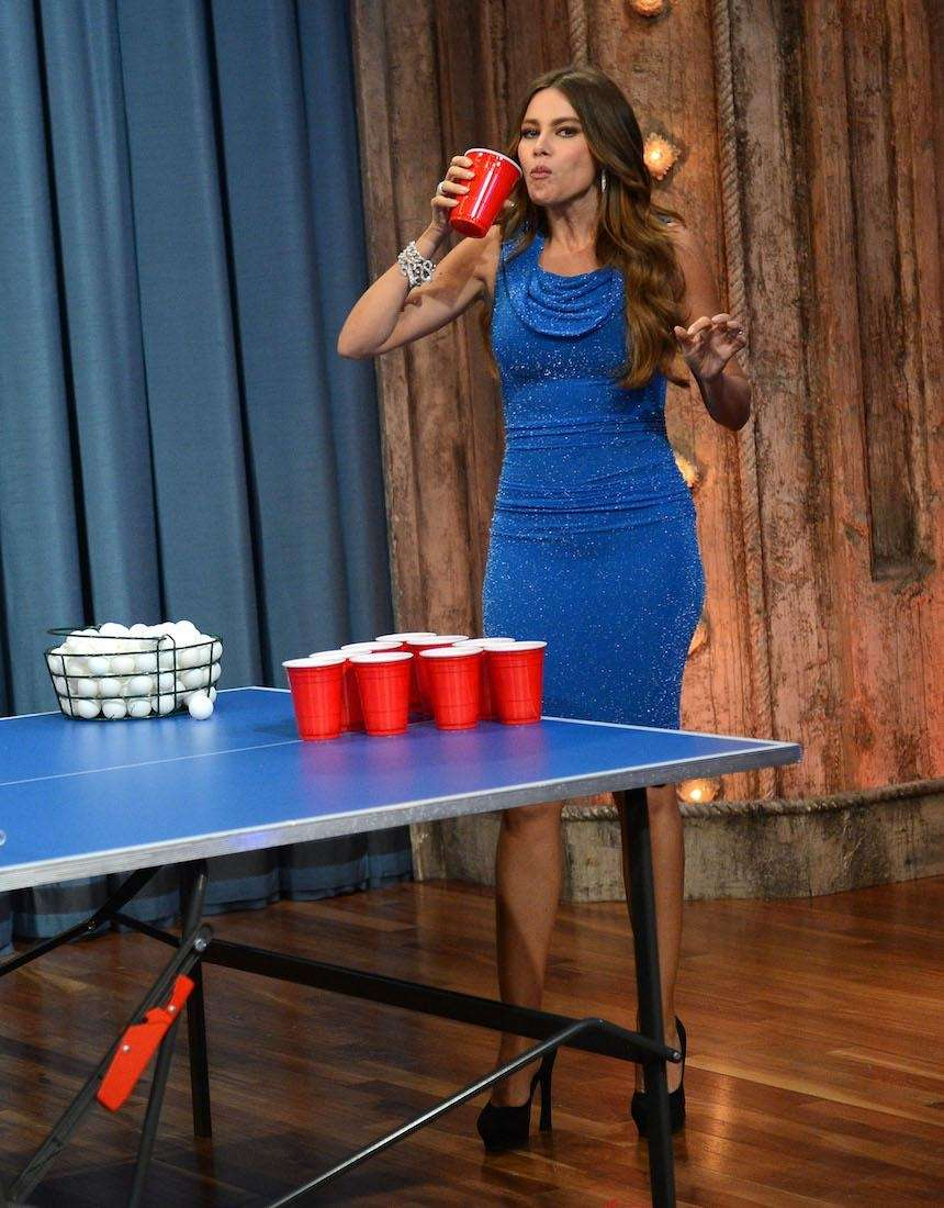 Actress Sofia Vergara plays beer pong during her