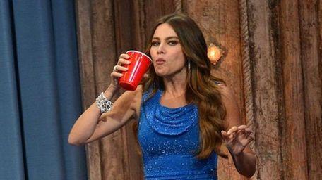 Actress Sofia Vergara plays beer pong during her