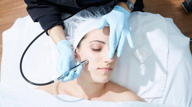 Dana Wilhelm from Baldwin receives a microdermabrasion treatment,