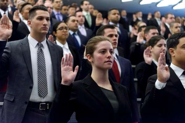 Brittney Roy, center, the daughter of NYPD Sgt.