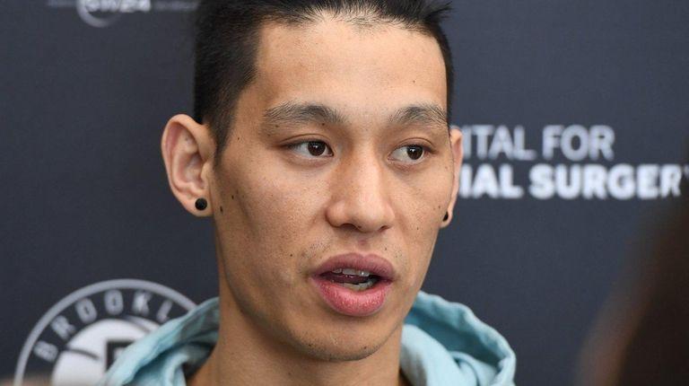 Brooklyn Nets guard Jeremy Lin speaks to the