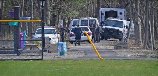 Suffolk County Police investigate the crime scene where