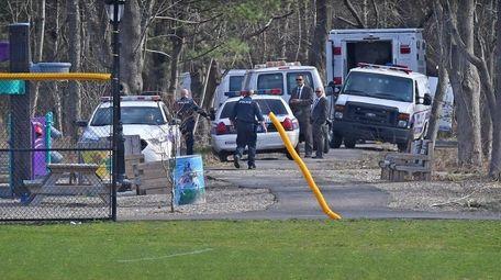 Suffolk County police investigate the crime scene where