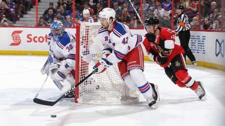 Brendan Smith of the Rangers skates with
