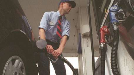 Andrew Ely pumps gas at a Mobil station