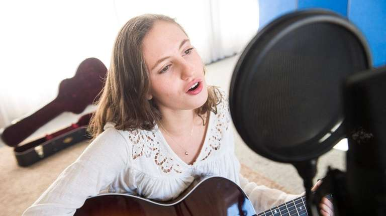 Maddy Seitles, 16, of East Moriches, sings in