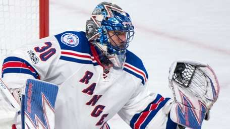 New York Rangers goaltender Henrik Lundqvist makes a