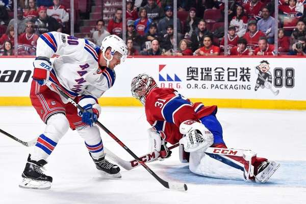 Rangers give up late lead, fall to Canadiens