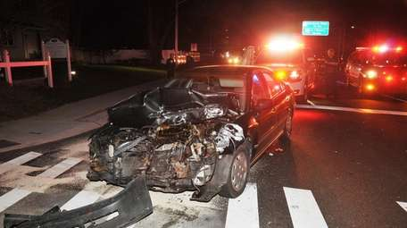 A driver was arrested after a three-vehicle crash