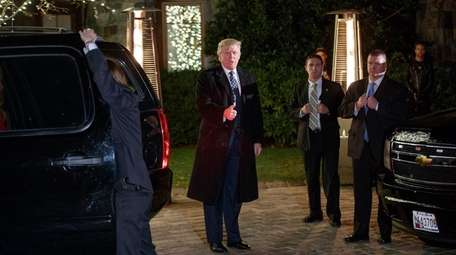 President-elect Donald Trump gestures at reporters on Dec.