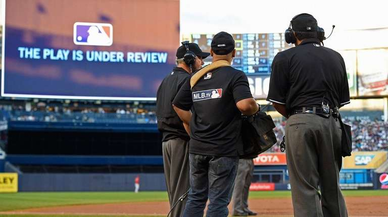 Umpires review a play at second base during