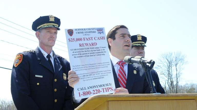 Suffolk County Police Commissioner Tim Sini speaks in
