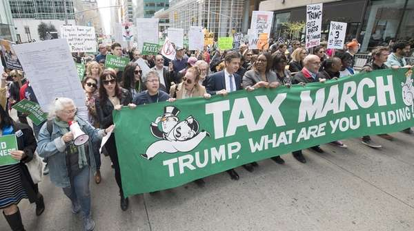 Protesters marched up Sixth Avenue, calling on President