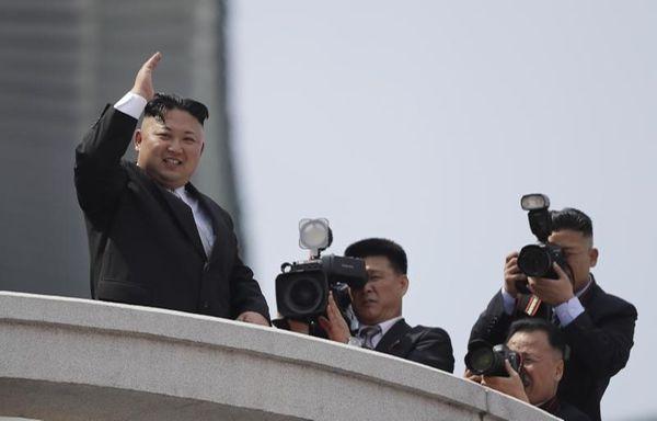 North Korean leader Kim Jong Un waves during